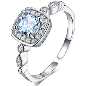 0.8 CT SKY BLUE TOPAZ ADJUSTABLE RING
